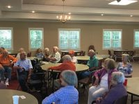 Keenagers at tables enjoying a program