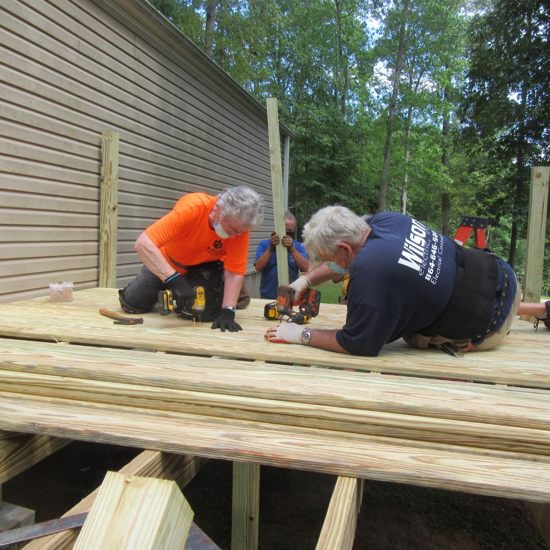 volunteers working on deck