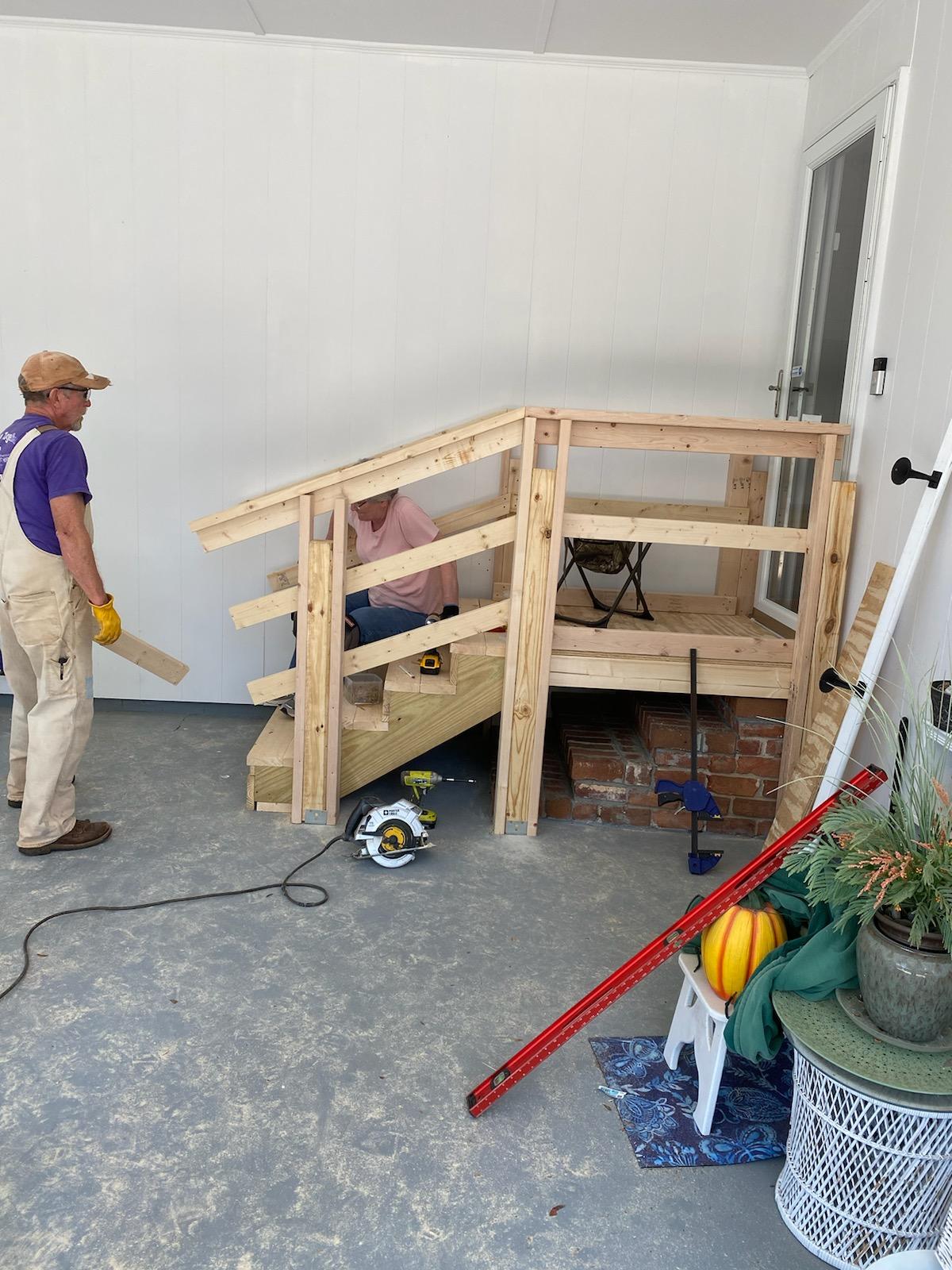 volunteer building a handrail